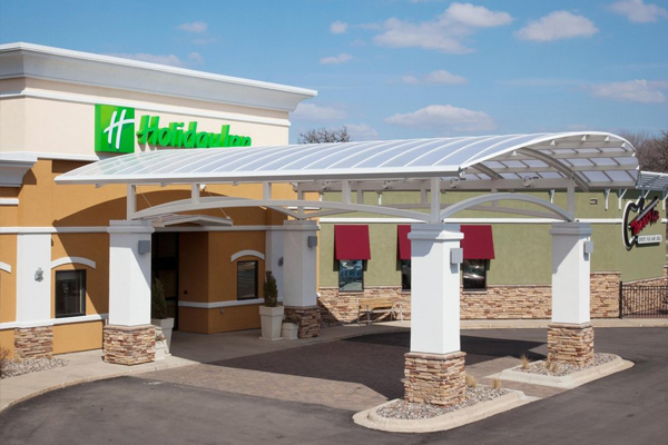 Premier Hotel Properties - Holiday Inn building entry in Austin.